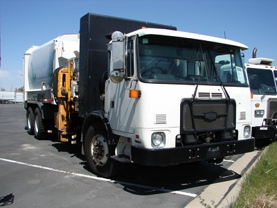 AUTOCAR GARBAGE TRUCKS - 4 AVAILABLE